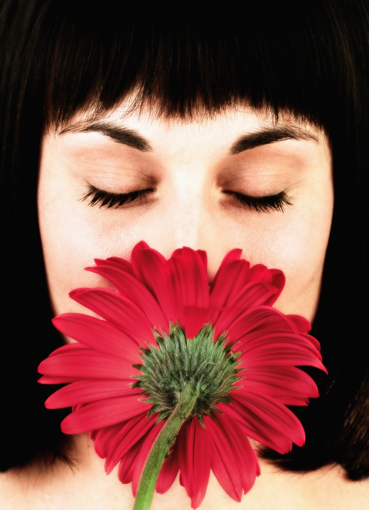 Woman Smelling Red Flower