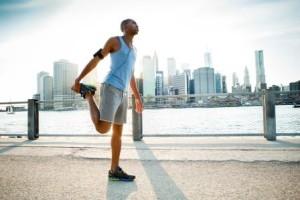 man warming up for jog