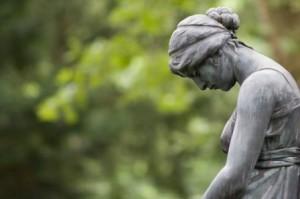 embracing grief sad statue
