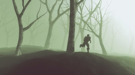 Silhouette of lost man running through misty winter forest.
