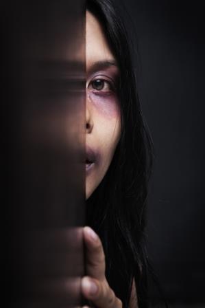 Injured woman hiding in dark