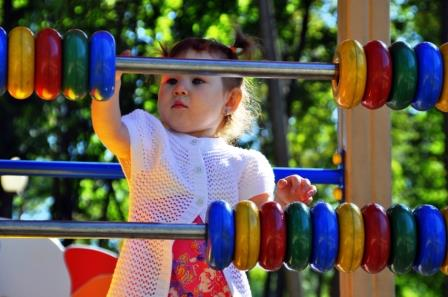 The little girl said colored rings at the playground