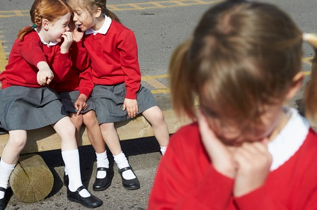 Elementary School Pupils Whispering In Playground