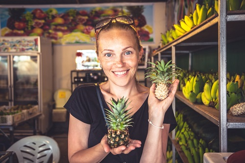 Beautiful cheerful woman tourist travel lifestyle portrait on loacal market during travel holidays in exotic tropical country