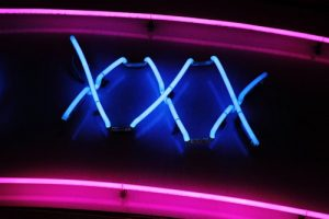 xxx neon sign compulsive sexual behaviour