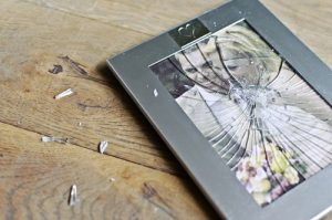 smashed photo frame shows grief after an abusive relationship
