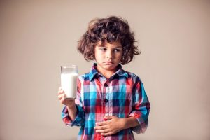 is food making you sick like this little boy with milk giving him a sore tummy?