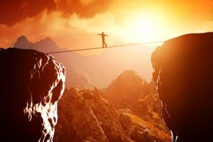 Making A Change man on tightrope